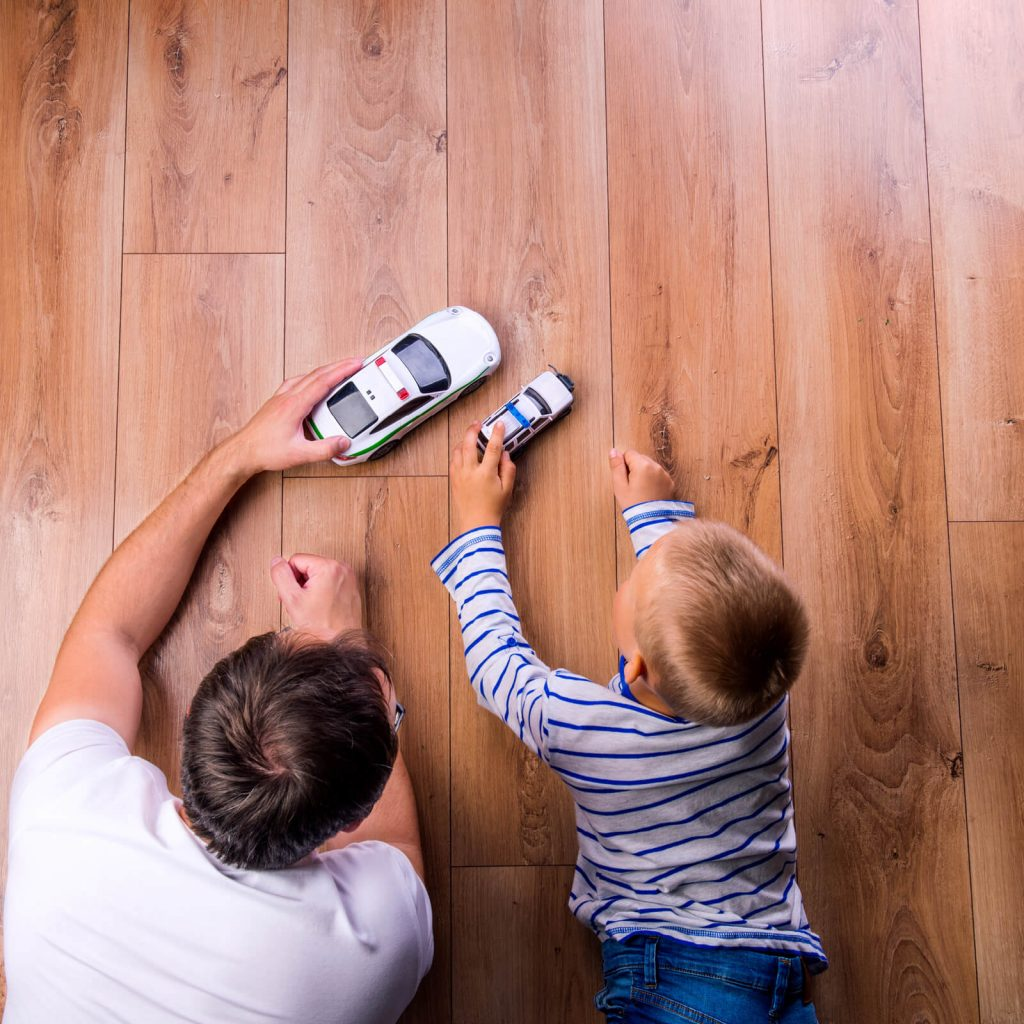 Father and kid playing with toycar | Piedmont Floors