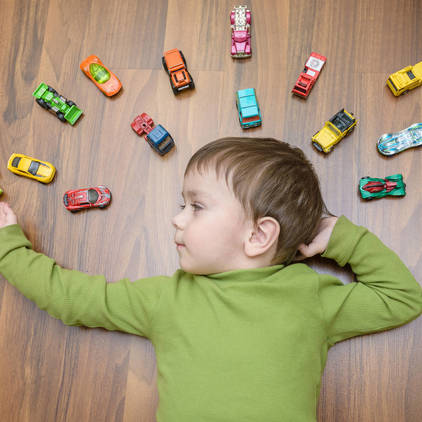 Kid with toycars | Piedmont Floors